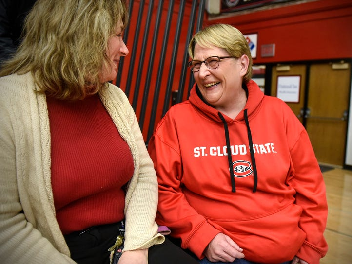 Dawn Schenk (right) shares a laugh with athletic director