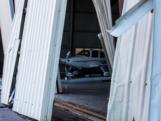 A plane sits in a hangar damaged by Hurricane Irma at the Naples Municipal Airport on Tuesday, Sept. 12, 2017.