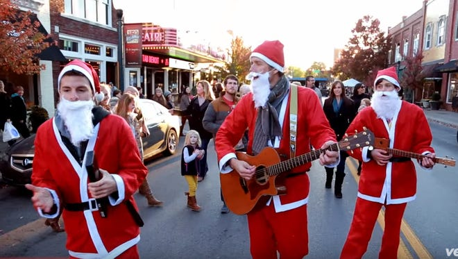 """The Band of Merrymakers perform in downtown Franklin in their video for """"Must Be Christmas."""""""