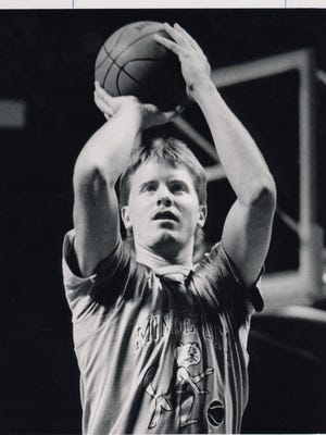 Jim Shikenjanski, shown warming up during his college days playing for Minnesota in the Big Ten, was a 6-foot-9 center for Hononegah who averaged 19.7 points as a senior for a team that snapped Boylan's 38-game conference winning streak.