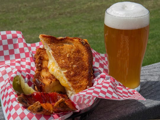 One of the dishes made at the Lucky Hare is a grilled cheese sandwich made with a blend of four cheddar cheeses, accompanied by hand cut potato wedges and a house made pickle. The beer paired with the grilled cheese sandwich is their Bavarian Hefeweizen, made with 70 percent wheat, 30 percent malt, using German hops and yeast in the brewing process.