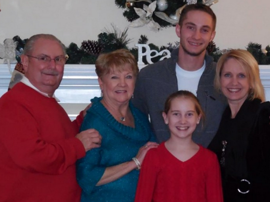 From left, Ron and Joan Hutchinson stand with their daughter, Michelle and two grandchildren, Taylor and Keenan. Michelle, a former Hartland Board of Education member, recently lost her two-year-battle to cancer.