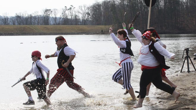 Some of the Shiver Me Timbers team raced into Deam Lake in Borden for an earlier Polar Plunge to benefit the Special Olympics of Indiana.