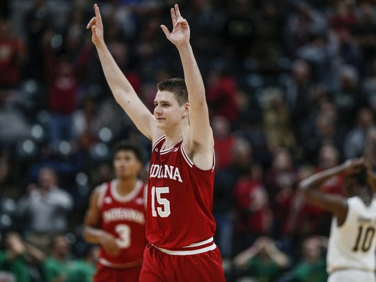 Zach McRoberts celebrates after IU's come-from-behind win over Notre Dame in the Crossroads Classic.