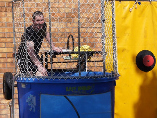 School board member Don Armstrong sits in a dunk tank to raise money for North Fort Myers Academy for the Arts in May.