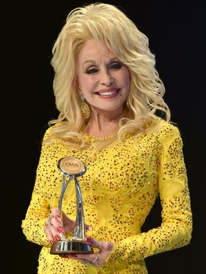 Dolly Parton was awarded the Willie Nelson Lifetime Achievement Award during the 50th annual CMA Awards on Nov. 2, 2016, at the Bridgestone Arena in Nashville, Tenn. She performs at 8 p.m. Friday at American Bank Center in Corpus Christi.
