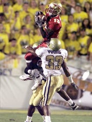 Marvin Minnis goes up over Ga. Tech's Chris Young to