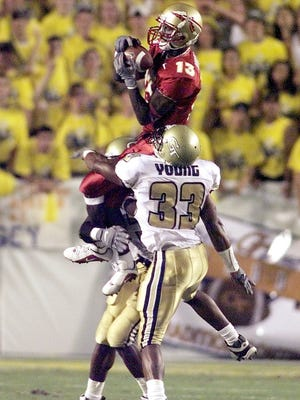 Marvin Minnis goes up over Ga. Tech's Chris Young to make the reception in the first quarter.