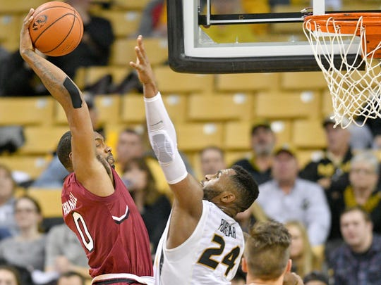 Jan 28, 2017; Columbia, MO, USA; South Carolina Gamecocks guard Sindarius Thornwell (0) goes up to dunk the ball as Missouri Tigers forward Kevin Puryear (24) defends during the second half at Mizzou Arena. South Carolina won 63-53. Mandatory Credit: Denny Medley-USA TODAY Sports