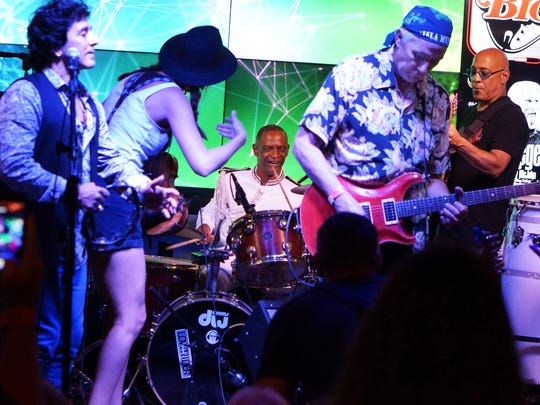 in Taylor (center on drums) performs with artists such as Steve Ilouis (left) of Great White, violinist Brie Cherry and guitarist Greg Douglass of the Steve Miller Band at a benefit performance at the Big Rock Pub in Indio.
