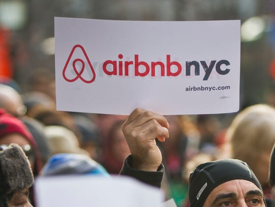 In this Jan. 20, 2015 file photo, supporters of Airbnb