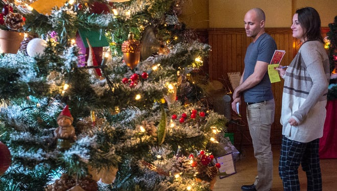 Ronald Corden and Kimberly Dethlefsen from Lansing check out the 4th annual Festival of Trees at the Turner Dodge House Saturday. The festival continues through Jan. 3.