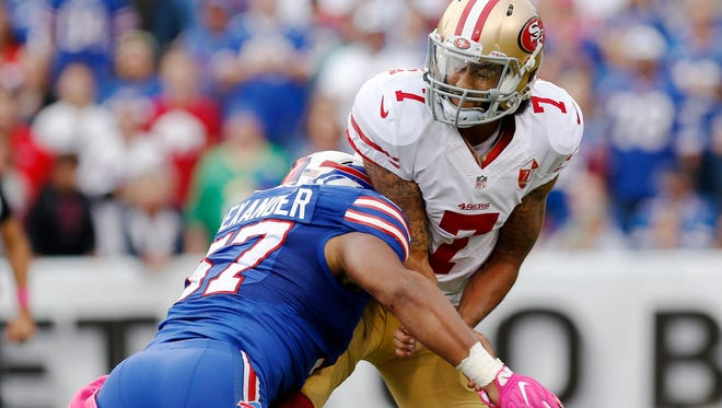 49ers quarterback Colin Kaepernick is hit by Bills linebacker Lorenzo Alexander during their game Sunday.