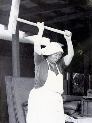 Hajime Musashi pounding sweet rice for mochi in preparation for Japanese New Year's in Oasis, CA. March 8, 1934.