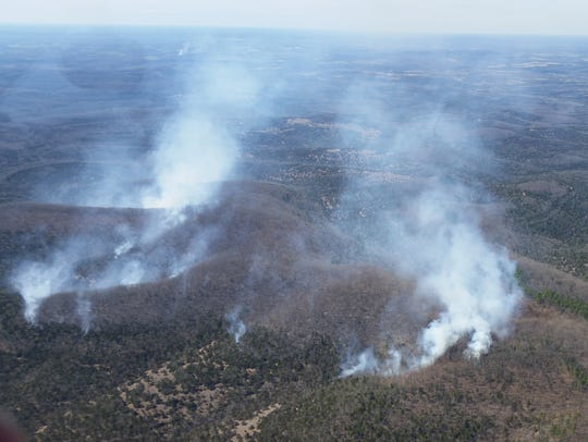 A spotter plane flew above the wildfire at Hercules
