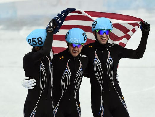J.R. Celski, Eduardo Alvarez, and Chris Creveling celebrate after finishing second in the Men's 5000m relay final.