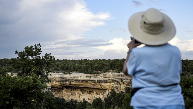 Erin Hull/The Coloradoan A woman takes a photo of Cliff Palace at Mesa Verde National Park. A woman takes a photo of Cliff Palace, one of the larger cliff dwellings in the park, Wednesday, June 24, 2015 at Mesa Verde National Park.