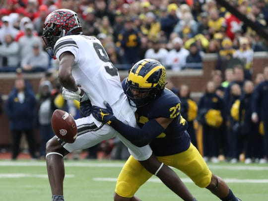 Michigan's Tyree Kinnel breaks up a pass to Ohio State's