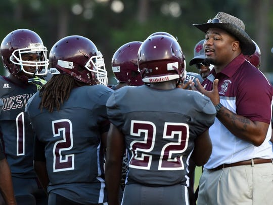 Aaron Sheppard (right), shown here in 2016, resigned Thursday as Fort Pierce Westwood's football coach.