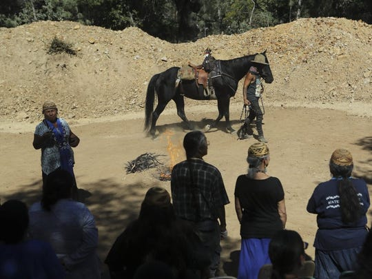 File photo - Winnemem Wintu Chief and spiritual leader Caleen Sisk in 2016 prays for the horses that will be riding from their village in Jones Valley to the McCloud River, on Wednesday, as Nahko Parayno of Santa Monica leads the horse he will be riding. The Winnemem were nearing completion of their 300-mile prayer journey from the Bay Area to the historical spawning grounds of the winter-run salmon on the McCloud River to raise awareness of salmon and water issues.