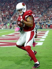 Arizona Cardinals wide receiver Michael Floyd (15) pulls in a touchdown pass in front of New York Jets cornerback Darryl Roberts on Monday, Oct. 17, 2016, in Glendale, Arizona.
