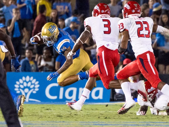 UCLA's Kazmeir Allen runs against Fresno State at the