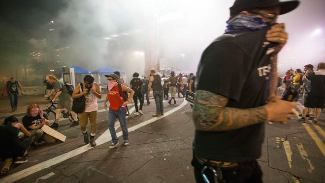 Phoenix Police use tear gas on Protester outside the Phoenix Convention Center. Michael Chow/The Republic