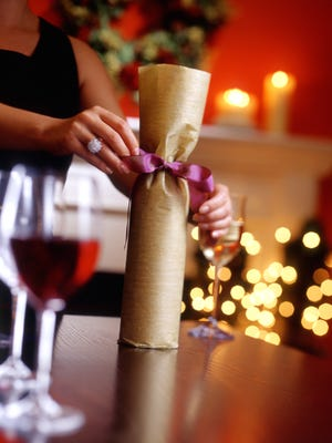A bottle of wine is always a welcome gift at a holiday party.