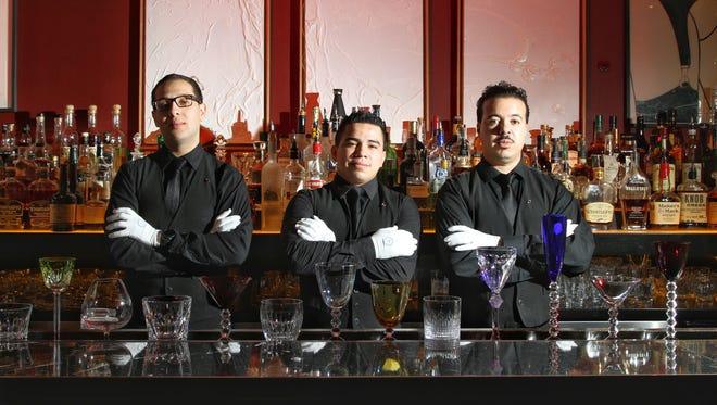 Glass attendants (left to right) Kenrick Morante, Brayan De La Cruz and Annis Semmane don white gloves.