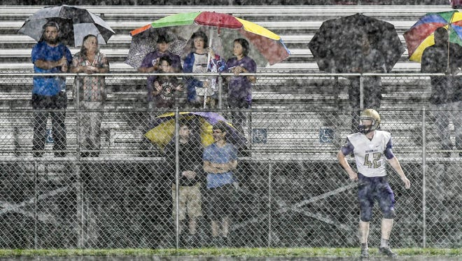 Only a few fans braved the rain to watch Okeechobee play Heritage Friday, Sept. 29, 2017, in Palm Bay.