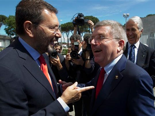 International Olympic Committee, IOC, president Thomas Bach, right, is greeted by Rome's mayor Ignazio Marino as he arrives to visit the Rome 2024 Olympic bid headquarters, in Rome on May 22, 2015.