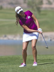Katie Perkins, from Desert Hills, chips onto the green at Southgate Golf Course Thursday, March 26, 2015.