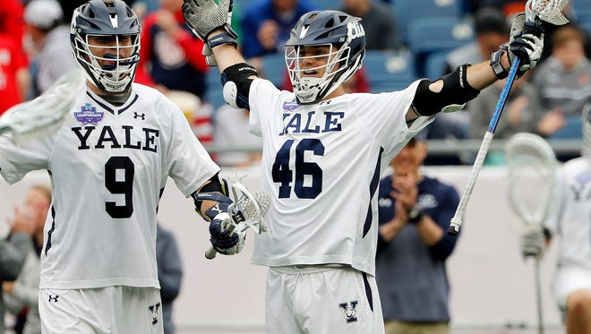 Yale's Brendan Rooney  celebrates after scoring a goal against Duke during the NCAA lacrosse championship game.