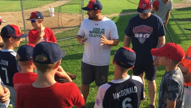 Wausau Nationals coach Jeremy Jirschele, center, talks to his players before the start of practice Monday. The Nationals are heading to the Great Lakes regional tournament this weekend in Indiana for the second straight year.