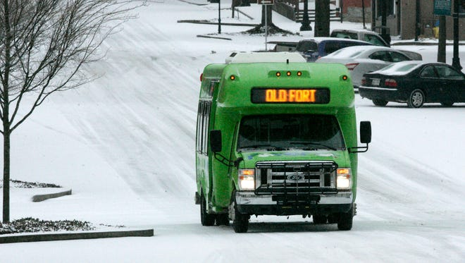 A Rover bus drives down West Main Street in the snow Thursday, March 5, 2015.