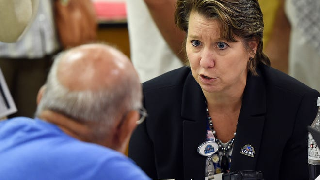 Wilmington VA Medical Center Director Robin C. Aube-Warren meets with a veteran at the Millsboro American Legion Post in 2015. VA officials said on Thursday that Warren had taken a job with another federal agency.