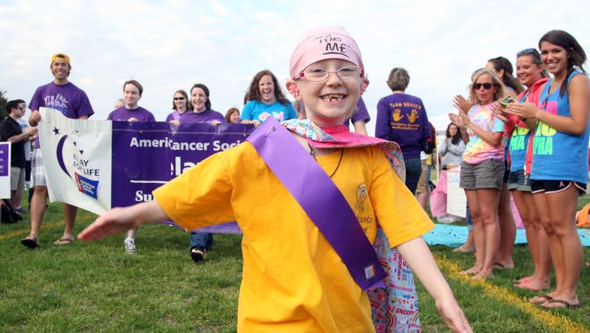 Brooke Mulford, 6 of Salisbury leads the Survivors Lap during the opening ceremonies for Relay for Life at Salisbury University's intramural fields in 2011.