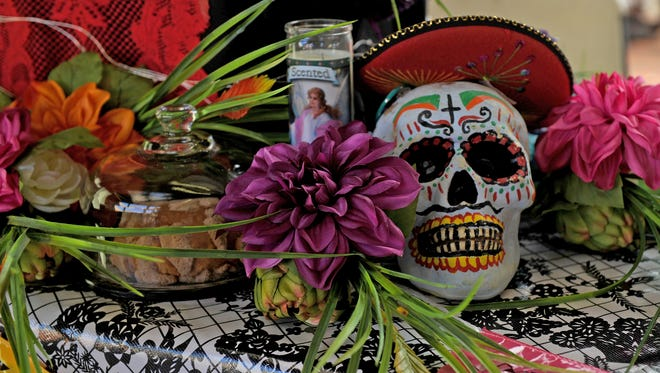 A Dia de los Muertos altar is set up at the 8th Annual Calle Ocho Saturday, Oct. 7, 2017, at the Wichita Falls Farmers Market.