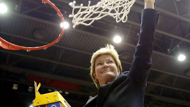 Pat Summitt waves the net after a 98-62 win over Ole Miss during the Dayton Regional final on March 27, 2007. Summitt died Tuesday.