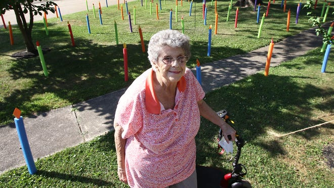Norma McFerren posing in front of 91 foam pool swim noodles made to look like birthday candles and placed in her Lily Lane yard by her children to celebrate McFerren's 91st birthday on Friday, July 17, 2020.