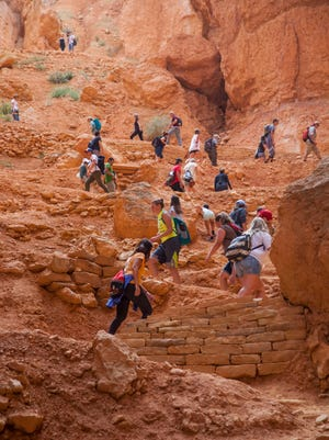 Southern Utah University students and tourists hike through Bryce Canyon National Park during the National Park Service centennial, Thursday, Aug. 25, 2016.