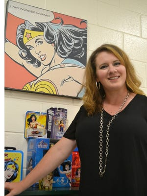 Amy Jennings stands her Wonder Woman themed corner of her classroom. Wonder Woman is her favorite superhero.