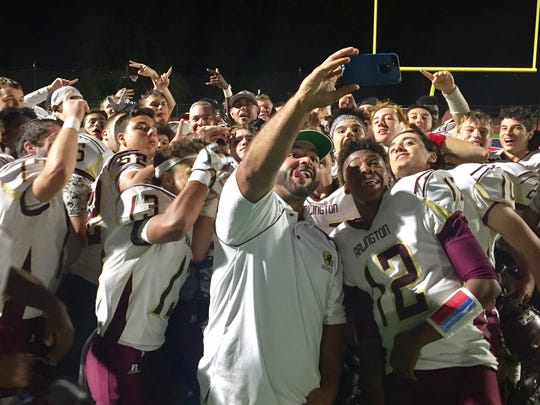 The Arlington football team poses for a celebratory group selfie after a win over Ketcham.