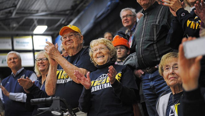 Augustana fans, including Mike and Sally Foss, cheer for their team during a National Championship celebration for the Augustana University men's basketball team Tuesday, March 29, 2016, at the Augustana University Elemen Center in Sioux Falls. Augustana beat Lincoln Memorial 90 to 81 in the NCAA Division II national championship on Saturday, March 26, in Frisco, Texas. Augustana's 2016 Division II national championship win was the program's first.
