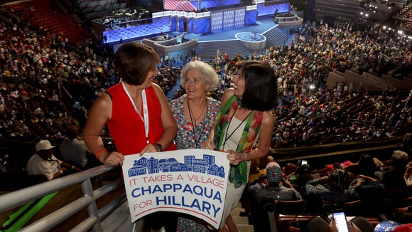 Beth Sauerhat, left, Julie Gaughran, and Randee Glazer are among a group of Chappaqua residents who are attending the Democratic National Convention at the Wells Fargo Arena in Philadelphia July 27, 2016. The group, in the hall for the third night of the convention have been Hillary supporters since she first announced her candidacy for president.
