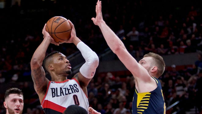 Portland Trail Blazers guard Damian Lillard shoots over Indiana Pacers center Domantas Sabonis during the second half of an NBA basketball game in Portland, Ore., Thursday, Jan. 18, 2018.