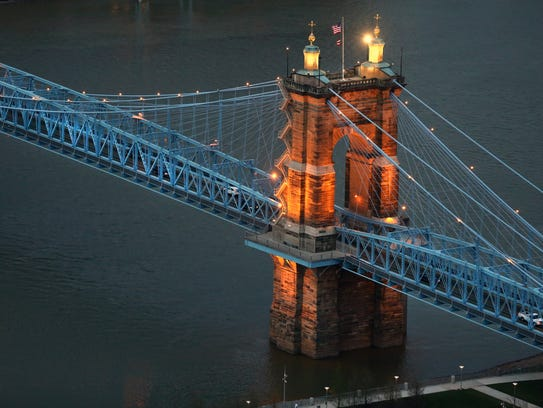 The John A. Roebling Suspension Bridge goes between