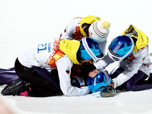 #15. Carina Vogt (Germany), gold in ski jump: Vogt was excitedly mobbed by teammates at the bottom of the hill after winning the first women's ski jump gold medal in history.