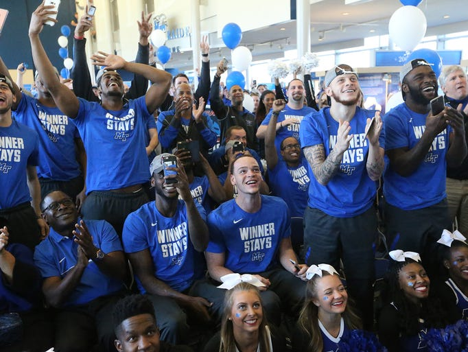 The MTSU Men's basketball team and fans celebrate being