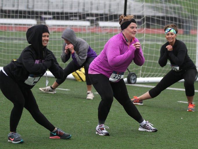Runners warm up before the start of RuNorwalk. The